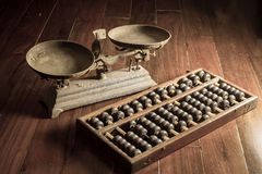 ancient-business-tools-old-scale-abacus-still-life-43267865